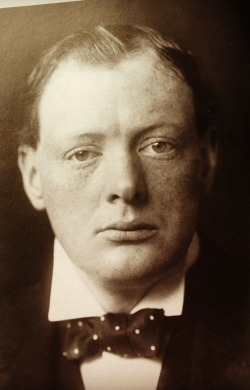 Ginger haired, freckle faced. Churchill at thirty. Sporting his later to be iconic, polka dotted bow tie.
