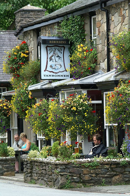 visitheworld:  Enjoying a drink outside the Tanronnen Inn in Beddgelert, Wales (by alanfrombangor).