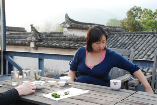 Sipping the Day's Tea on Rooftop in Anhui After a day long excursion to a remote tea producing village, exploring the tea fields, seeing first hand how the local green tea is produced entirely by hand, joining in production ourselves, we had a chance to sip our tea in the most idyllic of settings… The rooftop of Pig's Heaven Inn—a renovated, traditional Anhui home, nestled into the quiet village of Bishan with nine charming rooms.  It was the perfect home base for our countryside tea explorations! __________________________________________________________ If you enjoyed this article, sign up for Tranquil Tuesdays' newsletter to  Explore the stories behind each of Tranquil Tuesdays teas and teaware Travel with Tranquil Tuesdays seeking the best teas and teaware in China Learn the historical and cultural elements that make Chinese tea and teaware so unique Sign up for Tranquil Tuesdays' newsletter now!
