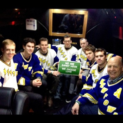 Coach Julien and B's sporting #Newtown High jerseys given to them by the NHS hockey team. #nhlbruins