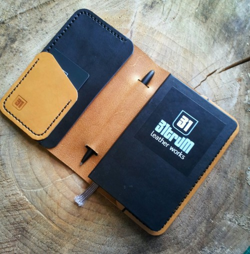 A 140x90 moleskine cover with card and note pockets with a pen slot