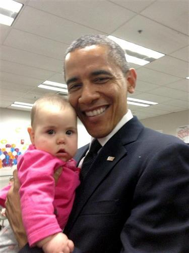 Slain Sandy Hook principal's daughter tweets photo of her baby and Obama (Photo: Cristina Hassinger)  Before speaking Sunday at the interfaith vigil in Newtown, CT for the victims Friday's Sandy Hook elementary school massacre, President Barack Obama met with families of those killed in the shooting. Read the complete story.