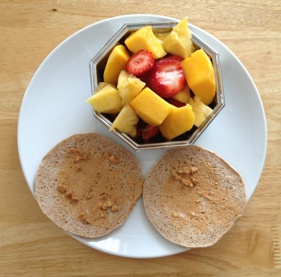 Breakfast: whole wheat sandwich thin with peanut butter and a side of fruit (pineapple, strawberries, and mango) (321 cals)