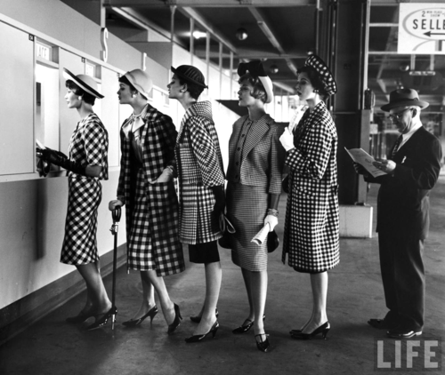 Nina Leen: 5 models wearing fashionable dress suits at a race track betting window, at Roosevelt Raceway. 1958