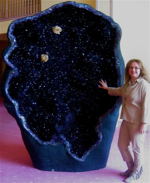 mineralists:  One of the world's largest amethyst geodes, the Empress of Uruguay, is located in Australia's Crystal Caves. It stands an alarming eleven feet tall and is filled with magnificent, deep violet crystals.  Seems like a galaxy made into a rock; so pretty!