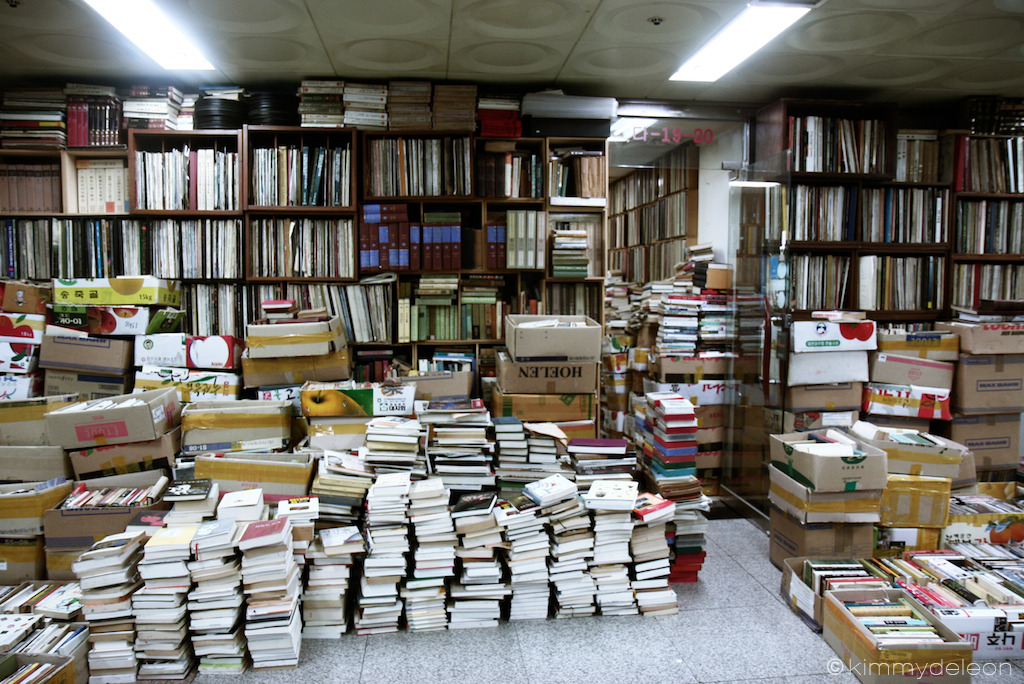 Overflowing Bookstore | Myeongdong, Seoul South Korea In one of the underpasses in Myeongdong, a bookstore was overflowing with books. You can't even tell if this is the inside of outside of the store.