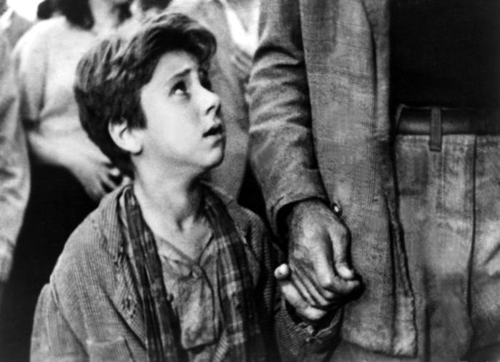 Ladri di biciclette (Bicycle Thieves), 1948  I have to admit I was afraid this was going to be one of those films that everyone understands it a work of genius but doesn't understand much else. 'Italian neorealism' that's a scary phase. But you don't need to get to caught up in big theory books and what the delicate significance are supposed to be because this is a film where it was very easy to just get immersed and follow the feelings. And when you did it was incredible. I knew vaguely what the film was supposed to be this slow build up of desperation after a man's bike is stolen, a bike he needs or he'll lose his job, until he hits rock bottom and becomes the thief himself. But I had no idea how beautifully crafted that build up would be. Antonio stood in the rain with him son at the market while dozens of bikes cycle past and he realises finding his will be like looking for a needle in a haystack - worse actually like looking for a particular piece of hay in a haystack. Or the way in which you're made the feel torn with him at the end of the film as you almost want him to take the bike because you can't see any other way out for him either. Beautiful film, deservedly a classic.