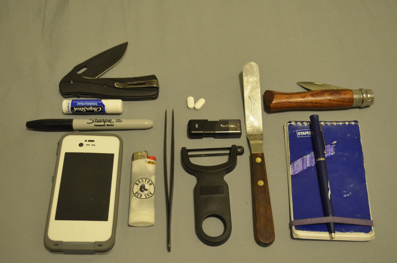 Chef Everyday Carry Submitted By: Jeff  Here's my EDC. I am a chef so its a little different.  Buck Vantage Folder - Purchase on Amazon Sharpie (most used tool) - Purchase on Amazon iPhone 4s in LifeProof Case - Purchase on Amazon Bic Lighter - Purchase on Amazon Plating Tweezers (for delicate work) - Purchase on Amazon Advil - Purchase on Amazon PNY 32g Flash Drive w/all of my recipes and photos Vegetable Peeler - Purchase on Amazon Atco Offset Spatula (used for everything from plating to tasting to tighten screws) Notebook & Pen Opinel Oyster Knife w/olivewood handle - Purchase on Amazon