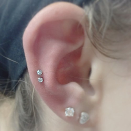 Fresh double cartilage piercing.  (at Lucky Rabbit)