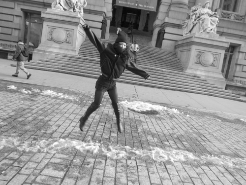 "Sandy Kim jumping for joy in front of the old Customs House from a series of photographs entitled ""Sandy Kim In The Center Of The Earth"".  Photo by Brad Elterman"