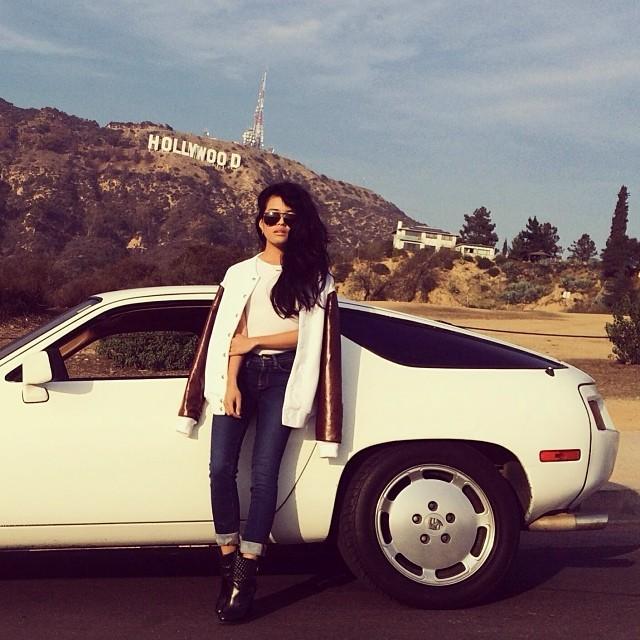 Another gem from @lusttforlife in her custom #apliiq snakeskin varsity jacket standing beside a 1979 Porsche 928 named Blanca. #porsche #lusttforlife #animalprint #leather #jacket #customize #oneofakind #madeinusa #designyourown #car #losangeles #hollywood