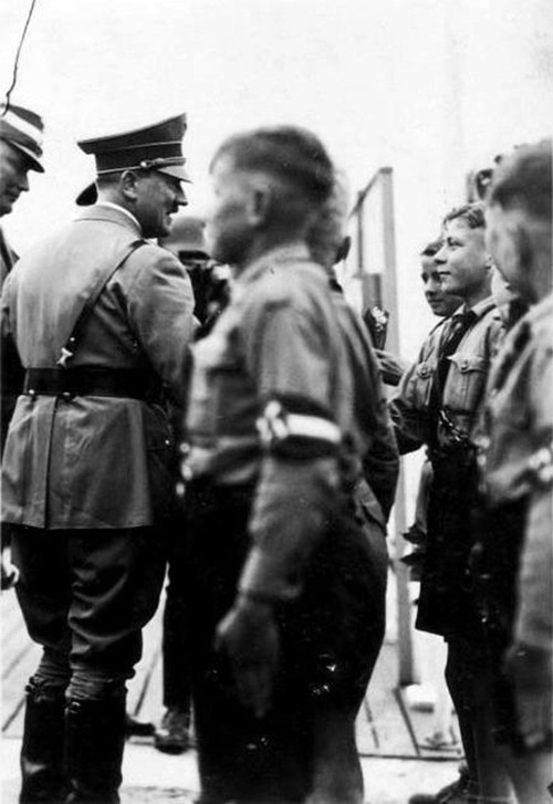 adolfi:  Adolf Hitler reviewing members of the Hitler Youth.  Is it wrong, that I want to know what happened to the young boy whose hand Hitler is about to shake?
