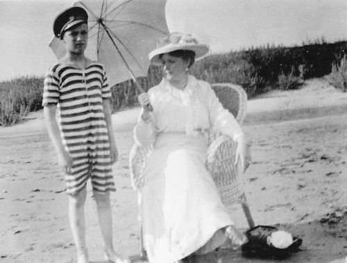 Tsarevich Alexei and Empress Alexandra on the beach: c. 1916.