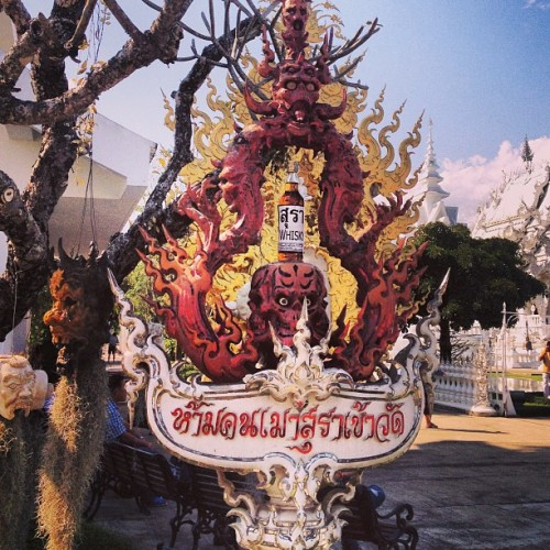 "instagram:   Thailand's White Temple, Wat Rong Khun (วัดร่องขุ่น) Located near the city of Chiang Rai, Wat Rong Khun (วัดร่องขุ่น)—known outside Thailand as the ""White Temple""—stands as an unusual and beautiful mix of traditional Thai architecture and modern-day science fiction memorabilia. It was designed by painter-turned-architect Chalermchai Kositpipat, one of Thailand's most renowned architects, who set out to create one of the most elegant temples in Chiang Rai. The temple's white color symbolizes purity; its glittering glass signifies the teachings of the Buddah; and the moat filled with outreaching arms represents desire. Detailed sculptures of skulls, demons and severed heads are also scattered around the premises. Perhaps most interestingly, a mural inside with images of Batman, Superman, and even the alien from Predator tell a modern-day story of Buddha. Construction on Wat Rong Khun began in 1996 and is expected to finish in 2070, long after Kositpipat has passed. Plans include nine buildings built on an area of about 3 acres, and though it is a work in progress, the temple attracts an increasingly large number of visitors every year—many of whom share their visit to the temple on Instagram."