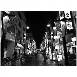 "| B&W (Red) Light District |  After exploring Ameyoko, a market street aka ""candy shop alley"", we stumbled our way down a red light district with many ""club"" greeters in suits scouting for clients.  This street is just southwest of the Ueno Station.   Taito, Tokyo is more of an ""old Tokyo"", also more of a ""working class"", lower rent, and with Ueno Park having one of tokyo's largest homeless populations.  There's definitely a different vibe from this district compared to other busy districts in #Tokyo.  #Japan #mytravelgram #mtgelite #travelingram #travel #Asia #travelphotography #symmetry #symmetrysundays #extremedepth #vanishingpoint #perspective #bw #bnw #blackandwhite #monochrome #grayscale #blackandwhitephotography (at 上野駅 (Ueno Sta.))"