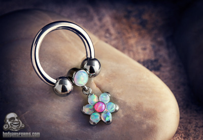 bodyartforms:  Custom circular barbell with bezel set flower dangle by Anatometal
