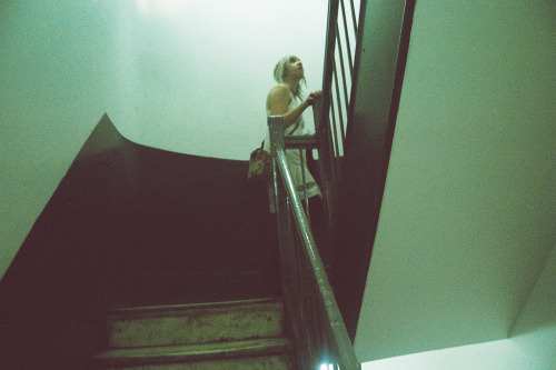 Paige going up her apartment stairs