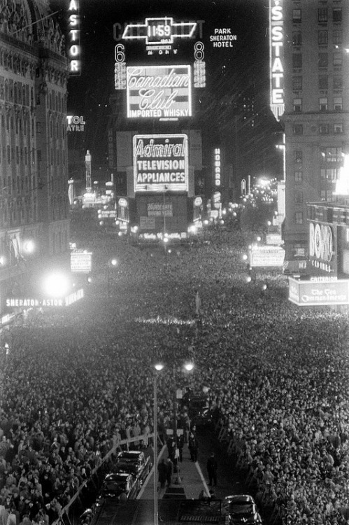 fuckyeahvintage-retro:  New Years party Times Square, 1956 © Walter Sanders