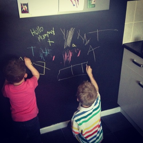 Nephews loving the blackboard wall we got in the kitchen.