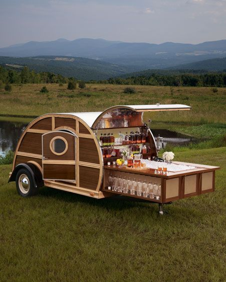 The Ultimate Tailgate Trailer The Bulleit Frontier Whiskey Woody-Tailgate Trailer by Neiman Marcus. Designed by interior designer Brad Ford, it's impressive on the outside, but what's on the inside truly astounds: sleek leather furnishings and details from Moore & Giles, rich wood finishings (handcrafted from reclaimed Bulleit Bourbon casks), elegant glassware, and a top-notch entertainment system, including a flat-screen TV, Blu-ray Disc™ player, and a state-of-the-art sound system, plus a one-year supply of Bulleit Bourbon and Bulleit Rye*. You park, open the hatch, and slide out the bar—cocktails anyone? The price? Only $150,000. And 10% of that goes to amFAR, the Foundation for AIDS Research. Source: Neatorama
