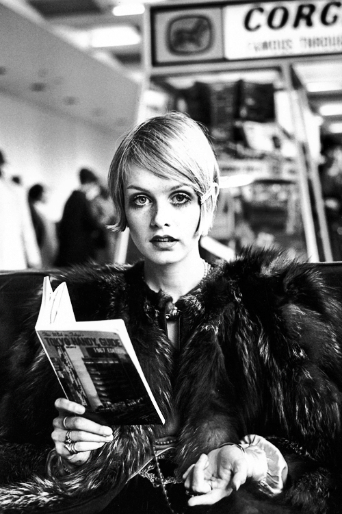 Twiggy reading a guide book to Tokyo at London Airport before departing for Japan, 1967