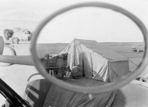 natgeofound:  Rear view mirror glimpse of Euphrates camp near Marl Cliffs, Iraq.Photograph by Maynard Owen Williams, National Geographic