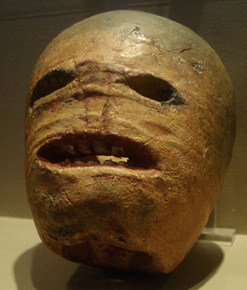 "archiemcphee:  This awesomely terrifying monstrosity is one of the world's oldest surviving jack-o'-lanterns. It was carved from a turnip during the 19th century, but we think it looks like something that could've been created by Edmund Blackadder's faithful Baldrick, known for his love of turnips. It's currently on display at the Museum of Country Life in County Mayo, Ireland. According to IrishCentral, Irish folklore claims the custom of carving jack-o'-lanterns at Halloween originated in Ireland, where turnips, mangelwurzel or beets were supposedly used before pumpkins came into play:  As the tale goes, a man called Stingy Jack invited the devil for a drink and convinced him to shape-shift into a coin to pay with. When the devil obliged, Jack decided he wanted the coin for other purposes, and kept it in his pocket beside a small, silver cross to prevent it from turning back into the devil. Jack eventually freed the devil under the condition that he wouldn't bother Jack for one year, and wouldn't claim Jack's soul once he died. The next year, Jack tricked the devil once more by convincing him to climb up a tree to fetch a piece of fruit. When he was up in the tree, Jack carved a cross into the trunk so the devil couldn't come down until he swore he wouldn't bother Stingy Jack for another ten years. When Jack died, God wouldn't allow him into heaven and the devil wouldn't allow him into hell. He was instead sent into the eternal night, with a burning coal inside a carved-out turnip to light his way. He's been roaming the earth ever since. The Irish began to refer to this spooky figure as ""Jack of the Lantern,"" which then became ""Jack O'Lantern.""  Head over to IrishCentral to learn more about this spooky piece of Halloween history. [via io9]"