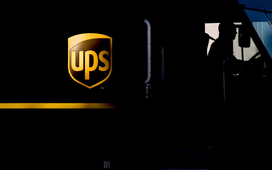 The silhouette of a driver is seen in a United Parcel Service (UPS) delivery truck at the distribution center in Sacramento, on Feb. 14. Photograph by Ken James/Bloomberg