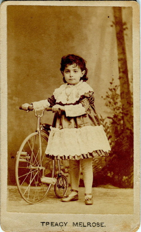 ca. 1870's, [carte de visite portrait of a young girl, identified as Treacy Melrose, with her baby highwheel bicycle], Baker & Potter via Ebay
