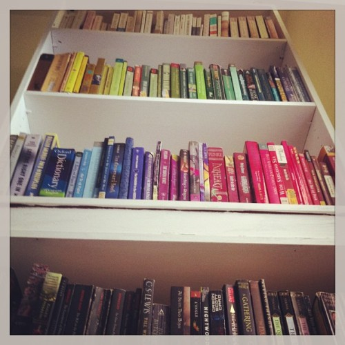 Fixing up Lily's room! We ordered the books by color again. All paperbacks here. All hardcovers in the living room. #rainbow #books #readingrainbow