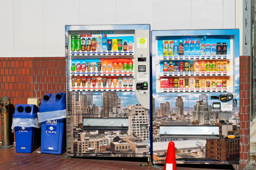 tokyo-fashion:  Vending machines covered in cityscapes on Cat Street in Harajuku.