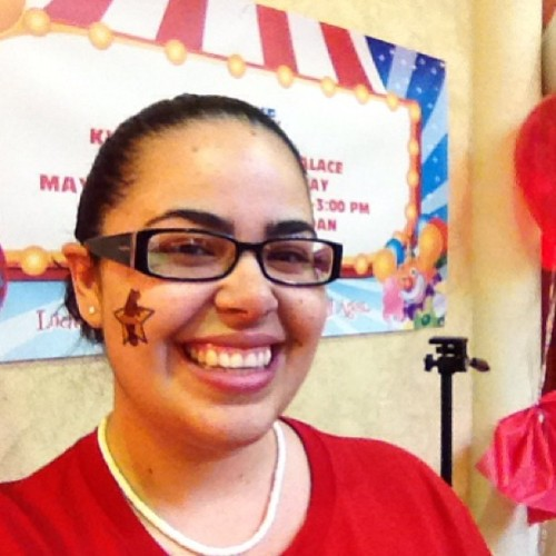 In charge of the temporary tattoo booth @ Red Day!! #redday #kw #circusday (at The Palace at Kendall - Senior Living)
