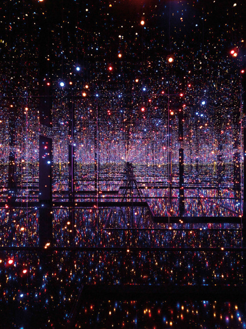 ryandonato:  Yayoi Kusama—a Japanese artist who is prominently known for having lived in a psychiatric institution for the past four decades—has been obsessed with infinity and dots for her entire artistic career, which she states to attribute directly to her hallucinations. As an attempt to share her observations, encounters, etc, she has created installations that delve into her obsessed visions of dots and infinitely mirrored space.