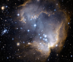 nasasapod:  NGC 602 and Beyond Image Credit: NASA, ESA, and the Hubble Heritage Team (STScI/AURA) - ESA/Hubble Collaboration Explanation: Near the outskirts of the Small Magellanic Cloud, a satellite galaxy some 200 thousand light-years distant, lies 5 million year young star cluster NGC 602. Surrounded by natal gas and dust, NGC 602 is featured in this stunning Hubble image of the region. Fantastic ridges and swept back shapes strongly suggest that energetic radiation and shock waves from NGC 602's massive young stars have eroded the dusty material and triggered a progression of star formation moving away from the cluster's center. At the estimated distance of the Small Magellanic Cloud, the picture spans about 200 light-years, but a tantalizing assortment of background galaxies are also visible in the sharp Hubble view. The background galaxies are hundreds of millions of light-years or more beyond NGC 602.