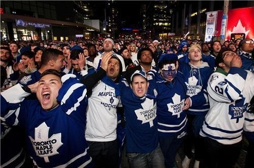 jjusttlistenn:  Maple Leaf Square after the Bruins won  It looks like 9/11 in here.