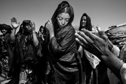 NIGER - Tuareg Nomad women dance at a baptism in the desert. This group has been in the region for the rainy season, taking advantage of easy water and good grasses for the animals.