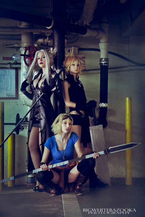 Lady Sephiroth (standing, left), Lady Cloud (standing, right) and Cid (sitting) from Final Fantasy VIICosplayers:Crystal Graziano [WW / TM / TW / dA] (Lady Sephiroth)Zalora Cosplay (Lady Cloud)OwlDepot (Cid)Photographer: Big White Bazooka [WW / TM / TW / dA]