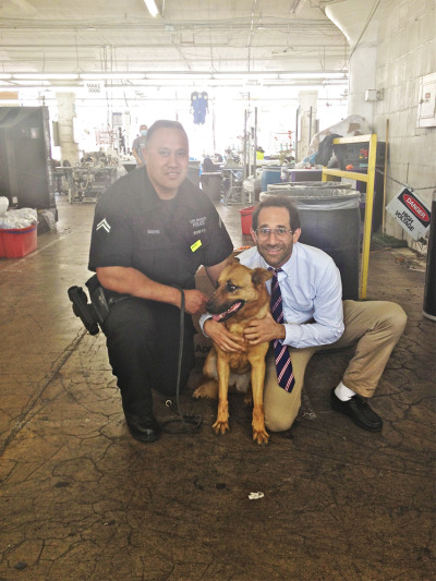 Dov and a police officer at our factory in Downtown Los Angeles.