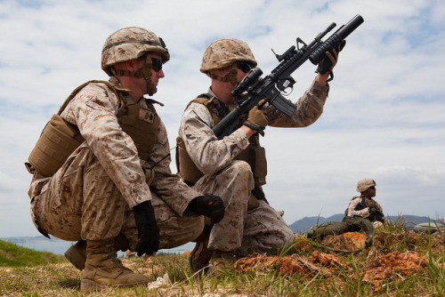 Infantrymen sharpen skills during live-fire training by III Marine Expeditionary Force/MCI Pacific on Flickr.Via Flickr: 130429-M-FD301-097 Staff Sgt. Owen I. Wood, left, watches as Lance Cpl. Erick M. Mistretta prepares to load an M203 grenade launcher during weapons systems familiarization and fire-and-maneuver exercises at Range 2 on Camp Hansen April 29. Marines also fired the M203 grenade launcher, AT-4 light anti-armor weapon and the MK153 shoulder-fired multipurpose assault weapon to increase proficiency. Following the weapons systems familiarization training, Marines conducted fire-and-maneuver rehearsals. Wood is a platoon sergeant and Mistretta is a rifleman. Both are with 3rd Battalion, 6th Marine Regiment, which is currently assigned to 4th Marine Regiment, 3rd Marine Division, III Marine Expeditionary Force, under the unit deployment program. (U.S. Marine Corps photo by Pfc. Kasey Peacock/Released)