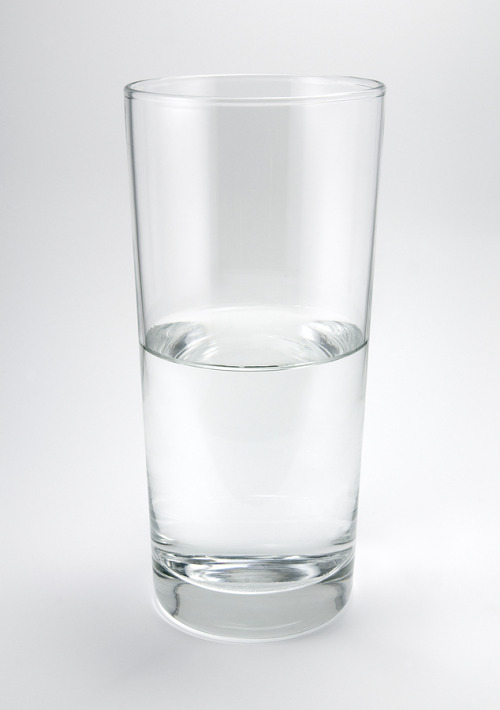 brentordono:  The glass is half-full. One of the popular philosophical questions has been: 'Is the glass half-empty or half-full?' and being an advocate of dualism, tells me that it should always be one or the other. In this article I try to explain in which status the glass is in and why through my own observation and some knowledge on scientific concepts. In a philosophical point of view, this question determines how a person thinks. The water in the glass is what we have; therefore, the glass is half-full to the optimist because of the things that he can still have while it is half-empty to the pessimist because of the things that he can lose until it is empty. If the law of Physics can be defied such that water exists on the upper half of the glass and nothing below it, then perhaps we have a glass that is half-empty. But this can never be. In fact, the glass is ideally always full; 1/2 water and 1/2 air but we only refer to the water as its content as a basis for observation.  In its physical structure, the glass is referred to as in an empty state because as a container, it holds nothing(?). Thus from the bottom of the glass until its mid portion is the same as saying from 'empty' to 'half-full' so when it's filled exactly to the brim it's 'full', in the brink of overflowing. But stating this also gives us that a glass in a full state will have the brim until the mid portion as 'full' to 'half-empty' and when it's rid of its contents all the way down to the bottom, it's 'empty'. I have therefore established, that the status of the glass given its water level depends on the direction of change. When the glass is in the process of being filled, it would have to reach the half-full point until it's full whereas if it's being emptied, it would have to reach the half-empty point until it's completely empty. So I ask, are we pouring or drinking? And for most, this is where the dreadful answer ends.  In another article that I've read, it asks; What if we don't know the past status of the glass when we come across it? It says we should look for clues, such that lip marks or water clinging on the inner walls of the glass would suggest drinking or recent pouring and therefore the glass would have to be half-empty. It also said that if no clues exist but the water is cold, it may suggest that it could have been recently poured and thus the glass is in the state of half-full. The article goes on to say that when a ninja places the glass such that no clues exist, it is half-empty because the water is naturally evaporating. If the glass is left alone and untouched, it will take molecular steps to be empty through evaporation therefore it is naturally half-empty. Taking all these into account, I first break the components down. Water is a substance in liquid state . It is inherently formless. Glass is a container and is in solid state. Science tells us that water will always take the shape of its container. So whether we are trying to drink from or fill a glass with water, we will always START by pouring water in the glass to contain or measure it. In effect, any glass is always half-full because the glass' innate purpose in this scenario is to hold water in place which will only happen when water is poured in it so that it is on its way to being half-full. This idea also proves superior to that excellent argument about water evaporation. The simple answer is: Water will not be in that state where it can evaporate without first being in that state where it's poured in the glass. By default, water must always be poured in the glass regardless of purpose thus the glass would reach the state of being half-full.