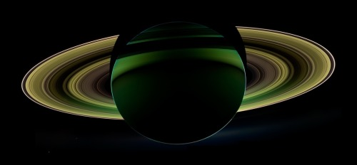 "Check out this stunning photo of a backlit Saturn, taken by the Cassini probe On Oct. 17, 2012, during its 174th orbit around the gas giant, Cassini was deliberately positioned within Saturn's shadow, a perfect location from which to look in the direction of the sun and take a backlit view of the rings and the dark side of the planet. Looking back towards the sun is a geometry referred to by planetary scientists as ""high solar phase;"" near the center of your target's shadow is the highest phase possible. This is a very scientifically advantageous and coveted viewing position, as it can reveal details about both the rings and atmosphere that cannot be seen in lower solar phase. Via"