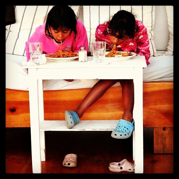 Slurping spaghetti with crocs. (at Santa Cruz, Lake Atitlan, Guatemala.)