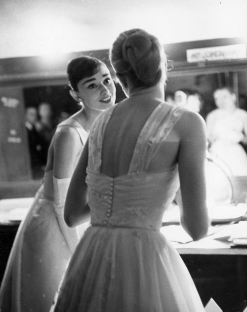 life:  Audrey Hepburn and Grace Kelly backstage at the RKO Pantages Theatre during the 28th Annual Academy Awards, 1956. See more photos here. (Allan Grant—Time & Life Pictures/Getty Images