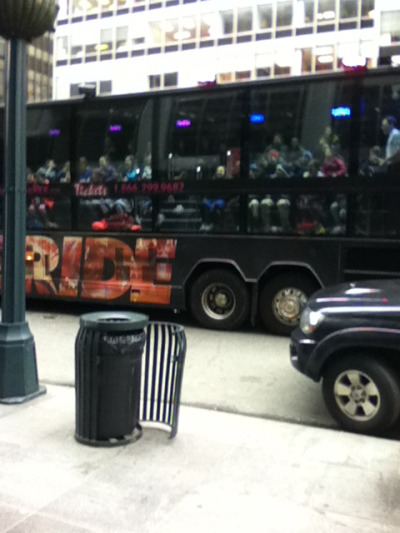 theres a tour bus in front of wwd's offices. it drives by every day. i believe they think this is the devil wears prada building. or maybe theyre really riveted by the building that also houses the economist group and the reader's digest association.