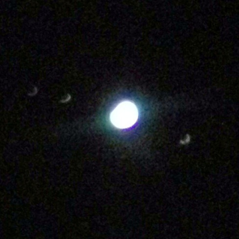 The Majestic Jupiter and three of its moons around it from my telescope, captured with my iPhone 4S (Sorry because of the Quality)