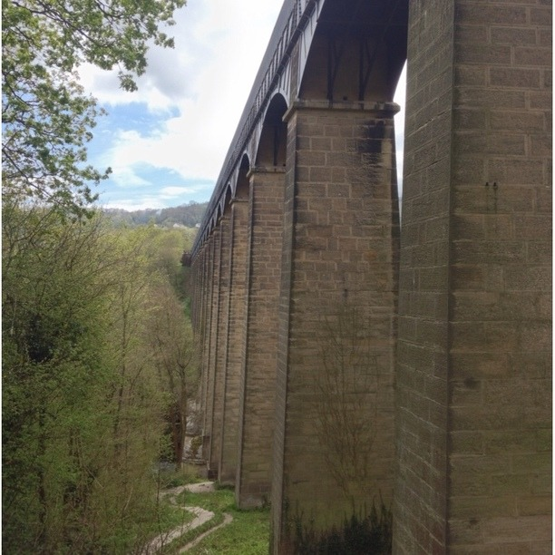 The aqueduct's construction, which began in 1795, was revolutionary at the time. Telford, rejecting all precedents, designed a cast-iron trough 3.25 metres wide and 307 metres long, laid along the top of 18 stone piers to carry the waterway high above the river.For the adventurous, it is possible to hire a canal boat both at Chirk Marina or at Trefor Basin and cross the aqueduct by boat. Alternatively there are canal boat trips available for those who want to sit and take it all in.  Discovered at Pontcysyllte Aqueduct, Wrexham, Wales. See more at Trover