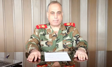 "thepoliticalnotebook:  Maj. Gen. Abdelaziz Jassim Al-Shalal, the Syrian military police chief, has defected to the rebels/opposition forces. In a video statement, he said:   ""The army has destroyed cities and villages and has committed massacres against an unarmed population that took to the streets to demand freedom. Long live free Syria.""   Photo: screenshot from his video statement from an undisclosed location. [The Guardian]  Another day, another sign the Assad regime is fading."