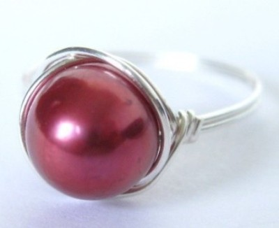 Etsy find: hot pink pearl ring - $13.50  She has a few other shades that would work: mauve, baby pink, white  I own the white one and wear it almost every day.  Adorable!