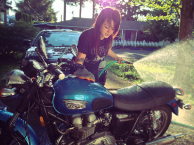 Jada (the roomie, motowifey) washin' and lovin' her (still very new to her) Triumph Bonneville after riding to Corvallis today.  [ more of Jada Noriyuki | tagged Triumph ]