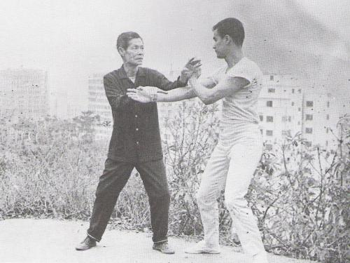zuky:  gentlemanwillsloan:  Bruce Lee with his martial arts master Ip Man, the subject of Wong Kar-wai's upcoming movie The Grandmaster.  Bruce Lee was an incredibly talented student of Ip Man's Wing Chun style, but he got in tons of trouble by beating up obnoxious peers in street fights, including sons of powerful gang bosses and police captains, forcing him to get the hell out of Hong Kong by the time he was 18 and start a new life washing dishes and bussing tables in San Francisco.